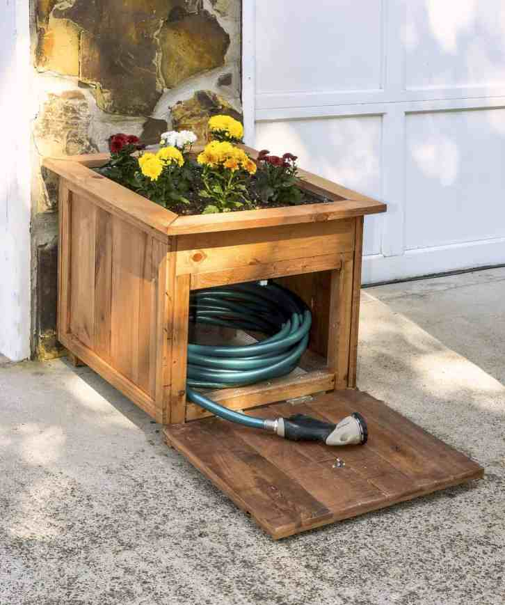DIY Pallet Wood Hose Holder with Planter by DIY Candy