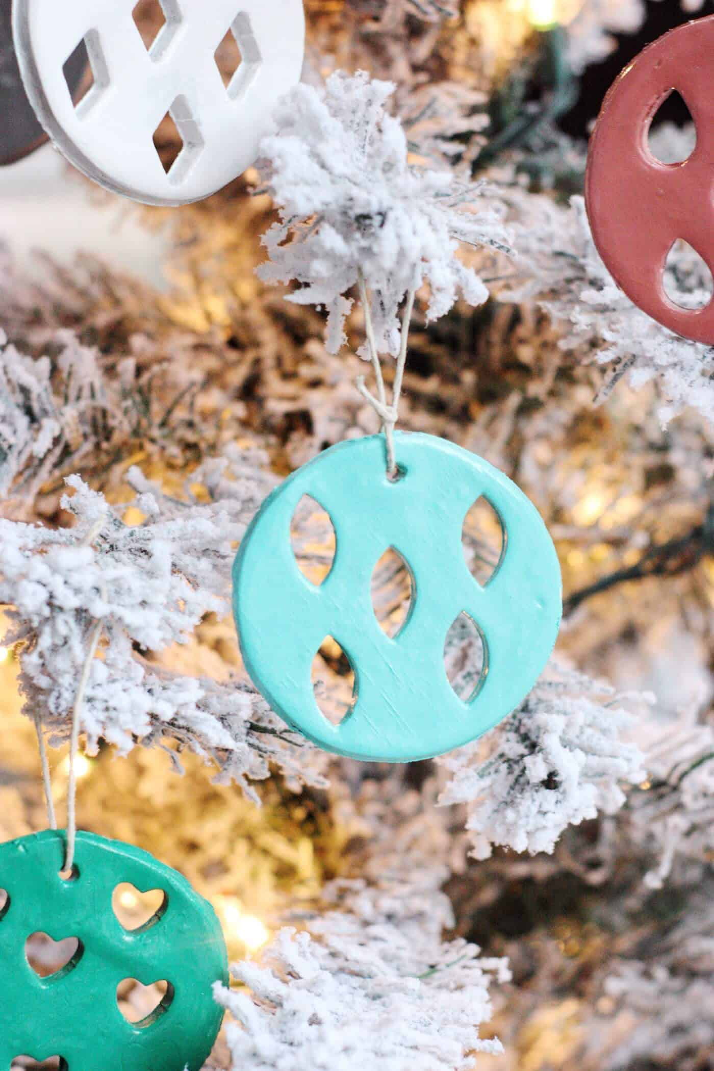 These clay Christmas ornaments are kid friendly but still look great on your tree! They are so easy to make; use your favorite paint colors.