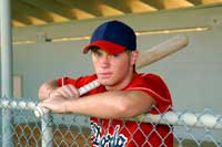 Baseball player in dugout