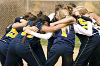 Softball team huddle
