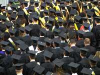 Students at college graduation representing comparing college graduate rates