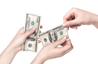 Hands with money representing the financial aid pre-read for athletes
