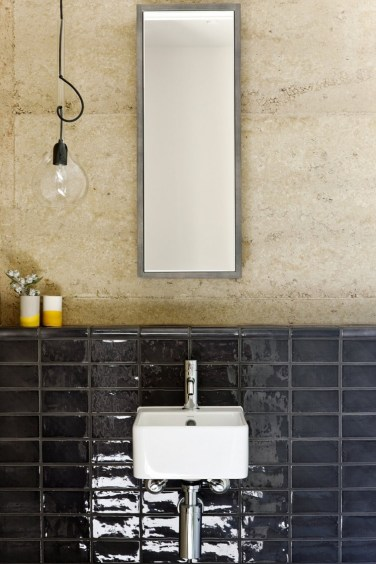 Exciting-Master-Bathroom-Interior-Details-with-Dark-Black-Glass-Tile-Backsplash-Setting-and-Bulb-Pendant-Lamp-to-Enhance-the-Vanity-Area-936x1406