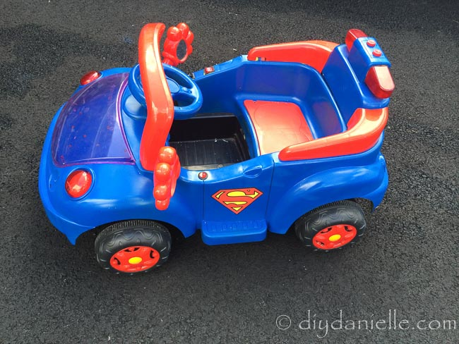 Superhero Car DIY: Superman ride on car with red and blue spray paint.