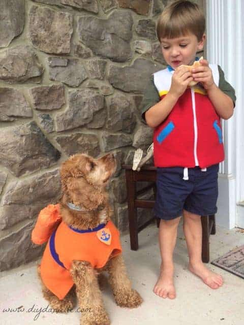 DIYDanielle has her dog dressed up as Zuma and her son as Ryder from Paw Patrol. This makes an easy and sensory friendly Halloween costume!