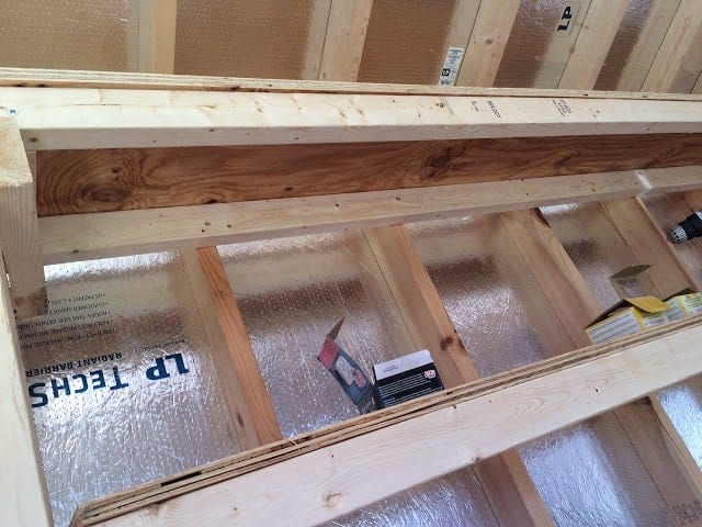 How to build shed shelving: Photo of the shelving from underneath. #woodworking #storage #organization