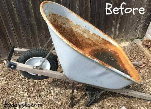 Old, rusted wheelbarrow.