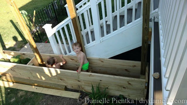 Kids playing in the deep privacy planters.
