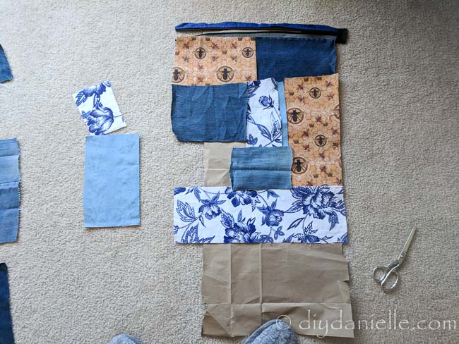 Patchwork pieces of fabric being put together for a DIY hobo bag.