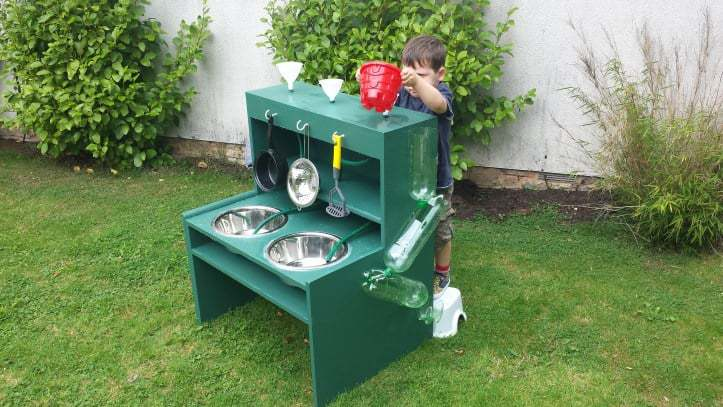 DIY mud kitchen idea for an outdoor kids space.