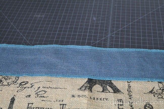 Blue burlap sewn over brown decorative burlap for edging.