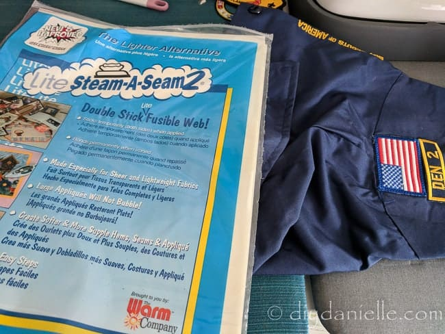 Using double stick fusible web to apply a Boy Scout's patch. This is great even if you plan to sew it on.