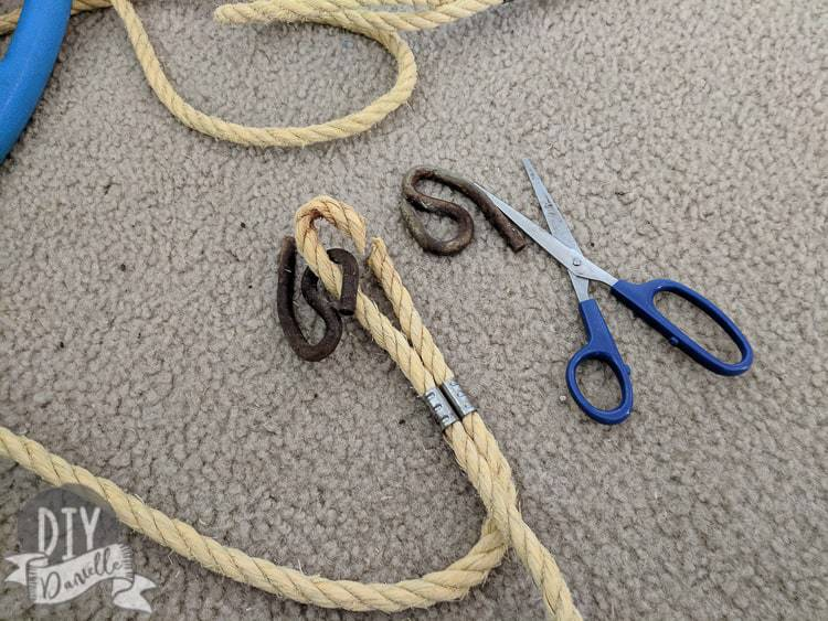 Cutting away the old rope and rusted hardware from a baby swing.