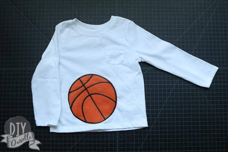 Basketball costume for a baby... just a shirt with a basketball on the stomach.