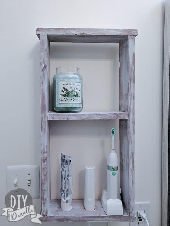 Toothbrush storage idea for the bathroom. This easy to build shelf is perfect!