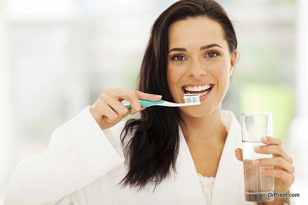 Cute woman brushes her teeth