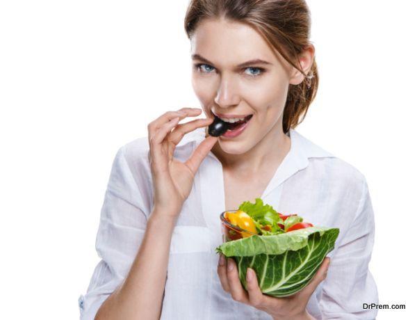 seductive european woman & vegetable salad - isolated on white background