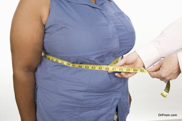 Doctor taking measures of overweight mid-adult woman