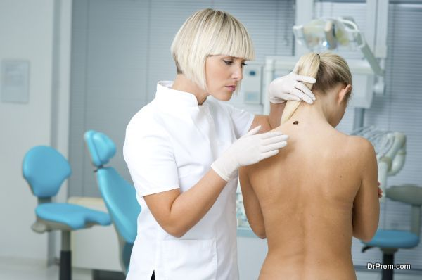 doctor examining woman skin for melanoma