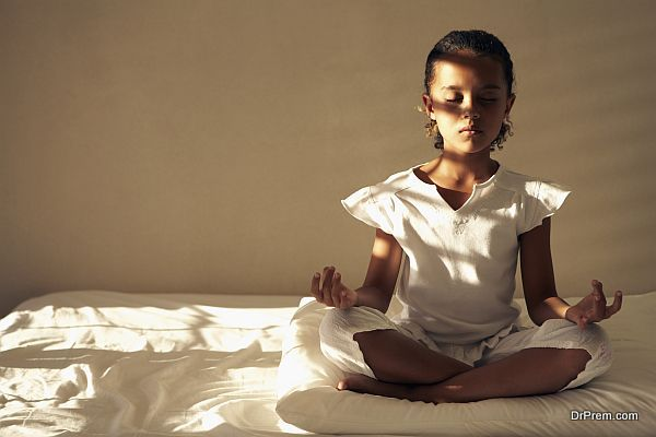 Girl Practicing Meditation in Bedroom