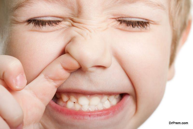 child pokes his nose
