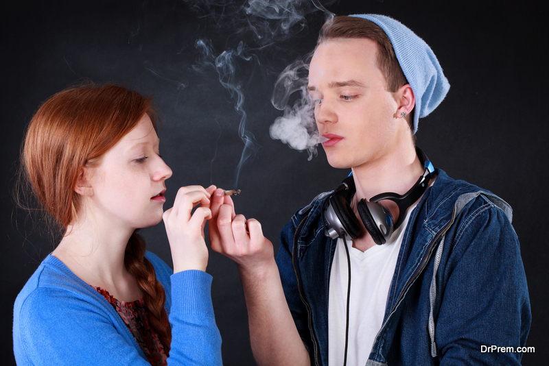 Teenagers smoking marijuana joint