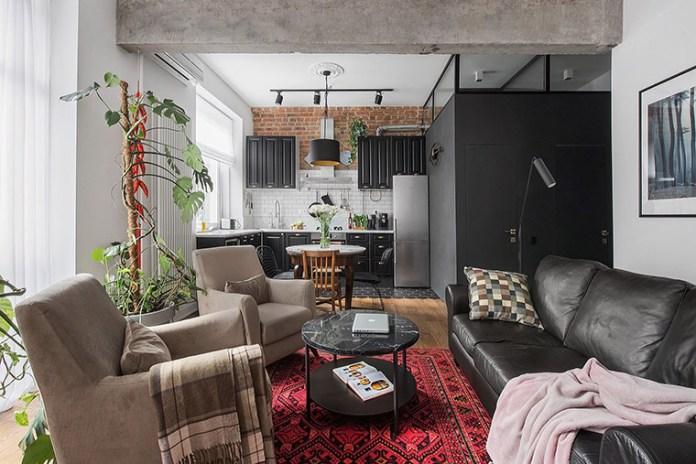 Apartamento urbano/industrial. Visão ampla da sala de estar e da cozinha