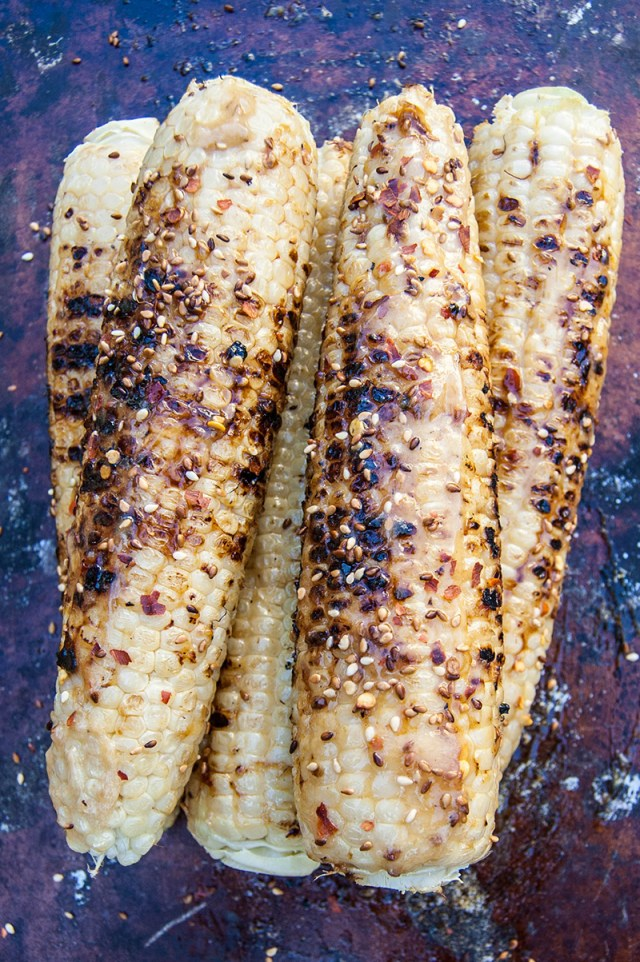 Caramelized honey miso butter grilled corn is a delicious twist on a summer barbecue staple. #miso #corn #grill #grilling #summer #recipe