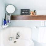Bathroom makeover: I added a vintage medical cabinet and reclaimed wood shelf ledge