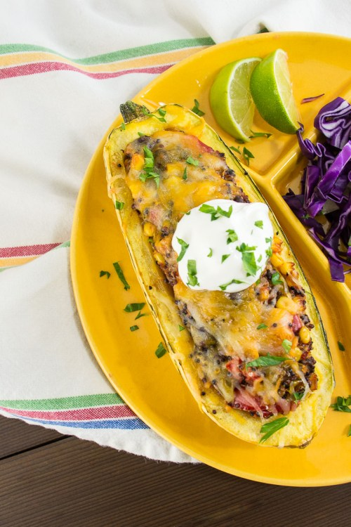 Delicata Squash Stuffed with Tex-Mex Veggie Quinoa - This flavorful vegetarian dish is loaded with healthy vegetables, but tastes more like a burrito than health food.