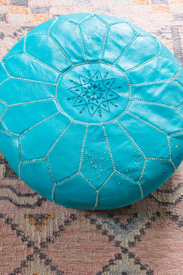 Scratched-up Moroccan leather pouf I'm going to re-cover