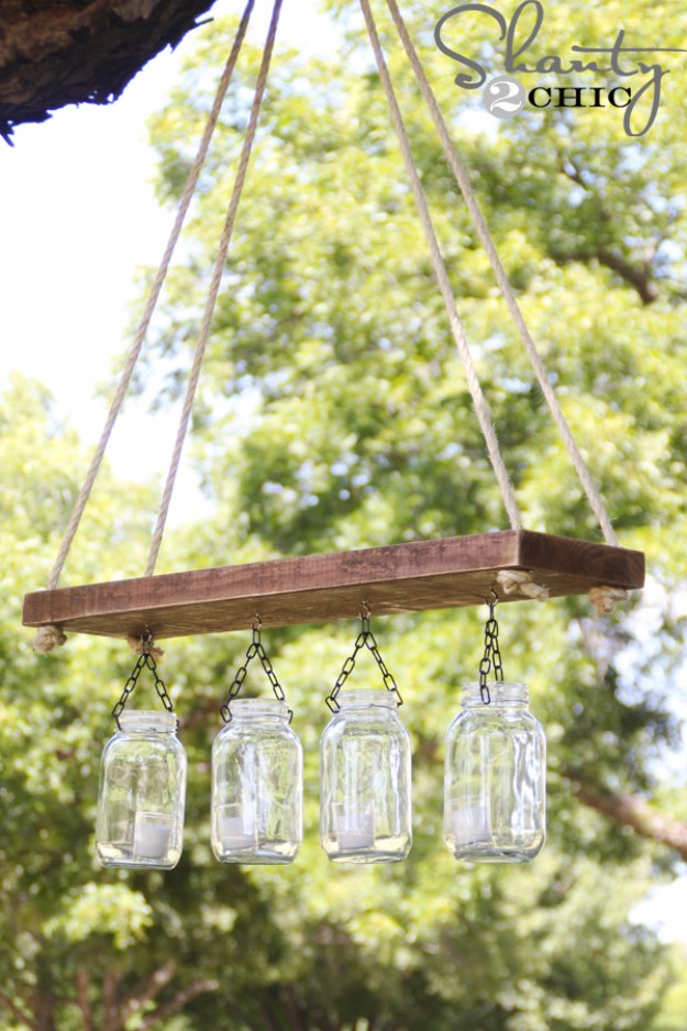 Mason Jar Lights - Outdoor Mason Jar Chandelier - DIY Ideas with Mason Jars for Outdoor, Kitchen, Bathroom, Bedroom and Home, Wedding. How to Make Hanging Lanterns, Rustic Chandeliers and Pendants, Solar Lights for Outside http://diyjoy.com/diy-mason-jar-lights-lanterns