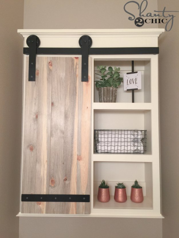 DIY Bathroom Decor Ideas - DIY Sliding Barn Door Bathroom Cabinet - Cool Do It Yourself Bath Ideas on A Budget, Rustic Bathroom Fixtures, Creative Wall Art, Rugs, Mason Jar Accessories and Easy Projects http://diyjoy.com/diy-bathroom-decor-ideas