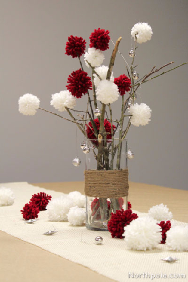 DIY Christmas Centerpieces - Sticks And Pom Poms Centerpiece - Simple, Easy Holiday Decorating Ideas on A Budget - Cheap Home and Table Decor for The Holidays - Dollar Store Crafts, Rustic Candles, Pine Cones, Floral Ideas and Mason Jar Craft Projects http://diyjoy.com/diy-christmas-centerpieces