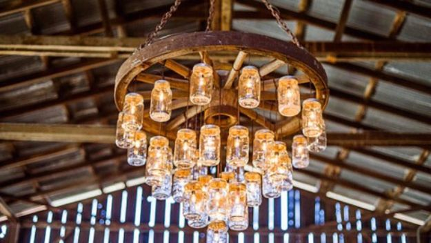 DIY Outdoors Wedding Ideas - Wagon Wheel Chandelier Made With Mason Jars - Step by Step Tutorials and Projects Ideas for Summer Brides - Lighting, Mason Jar Centerpieces, Table Decor, Party Favors, Guestbook Ideas, Signs, Flowers, Banners, Tablecloth and Runners, Napkins, Seating and Lights - Cheap and Ideas DIY Decor for Weddings http://diyjoy.com/diy-outdoor-wedding