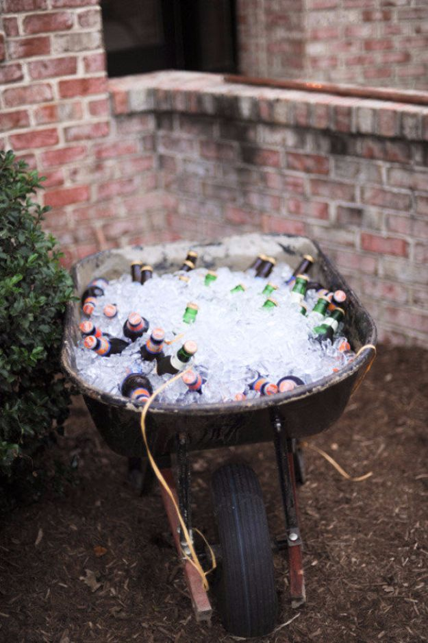 DIY Outdoors Wedding Ideas - Wheelbarrow Cooler - Step by Step Tutorials and Projects Ideas for Summer Brides - Lighting, Mason Jar Centerpieces, Table Decor, Party Favors, Guestbook Ideas, Signs, Flowers, Banners, Tablecloth and Runners, Napkins, Seating and Lights - Cheap and Ideas DIY Decor for Weddings http://diyjoy.com/diy-outdoor-wedding