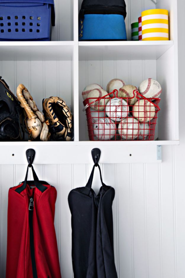 DIY Projects Your Garage Needs - Garage Sports Station - Do It Yourself Garage Makeover Ideas Include Storage, Mudroom, Organization, Shelves, and Project Plans for Cool New Garage Decor - Easy Home Decor on A Budget http://diyjoy.com/diy-garage-ideas