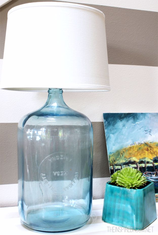 DIY Lighting Ideas and Cool DIY Light Projects for the Home - DIY Bottle Lamp - Easy DIY Ideas for Chandeliers, lights, lamps, awesome pendants and creative hanging fixtures, complete with tutorials with instructions. Cheap do it yourself lighting tutorials for indoor - bedroom, living room, bathroom, kitchen DIY Projects and Crafts for Women and Men http://diyjoy.com/diy-indoor-lighting-ideas