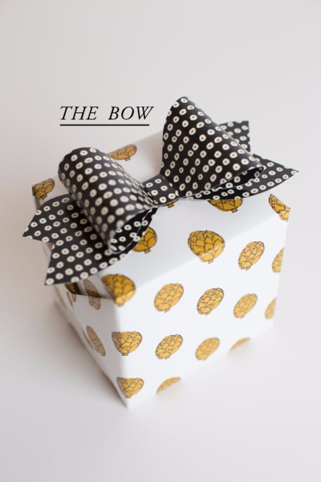 Creative Bows For Packages - Chic Bow - Make DIY Bows for Christmas Presents and Holiday Gifts - Cute and Easy Ideas for Making Your Own Bows and Ribbons - Step by Step Tutorials and Instructions for Tying A Bow - Cheap and Crafty Gift Wrapping Ideas on A Budget http://diyjoy.com/diy-bows-gifts-packages