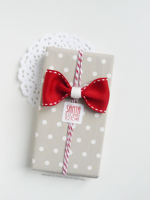 Creative Bows For Packages - Cute Gift Bow Tie - Make DIY Bows for Christmas Presents and Holiday Gifts - Cute and Easy Ideas for Making Your Own Bows and Ribbons - Step by Step Tutorials and Instructions for Tying A Bow - Cheap and Crafty Gift Wrapping Ideas on A Budget http://diyjoy.com/diy-bows-gifts-packages