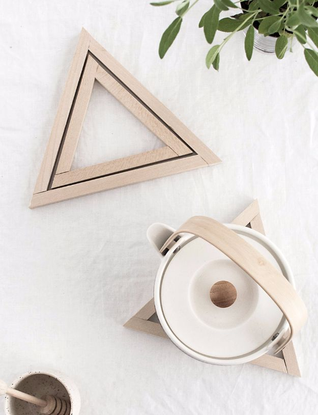 Cheap DIY Gifts and Inexpensive Homemade Christmas Gift Ideas for People on A Budget - DIY Wood Triangle Trivets - To Make These Cool Presents Instead of Buying for the Holidays - Easy and Low Cost Gifts for Mom, Dad, Friends and Family - Quick Dollar Store Crafts and Projects for Xmas Gift Giving Parties - Step by Step Tutorials and Instructions http://diyjoy.com/cheap-holiday-gift-ideas-to-make