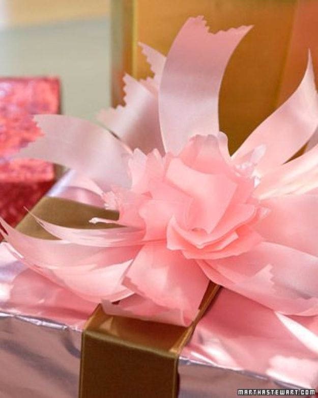 Creative Bows For Packages - Flower Bow - Make DIY Bows for Christmas Presents and Holiday Gifts - Cute and Easy Ideas for Making Your Own Bows and Ribbons - Step by Step Tutorials and Instructions for Tying A Bow - Cheap and Crafty Gift Wrapping Ideas on A Budget http://diyjoy.com/diy-bows-gifts-packages