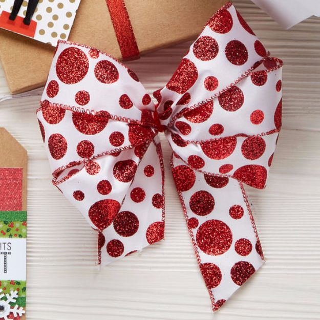 Creative Bows For Packages - Glitter Polka Dot Bow - Make DIY Bows for Christmas Presents and Holiday Gifts - Cute and Easy Ideas for Making Your Own Bows and Ribbons - Step by Step Tutorials and Instructions for Tying A Bow - Cheap and Crafty Gift Wrapping Ideas on A Budget http://diyjoy.com/diy-bows-gifts-packages