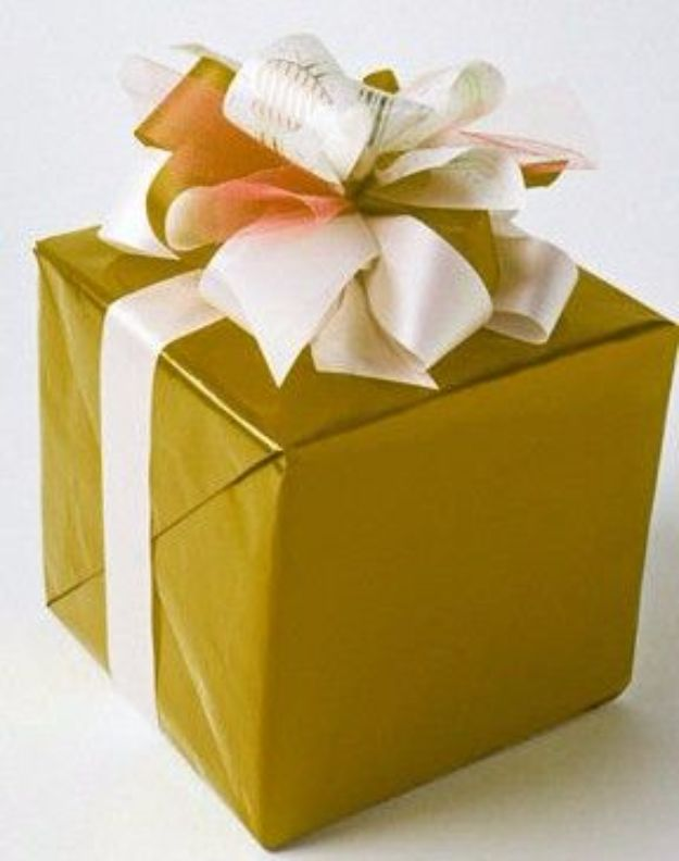 Creative Bows For Packages - Layered Bow - Make DIY Bows for Christmas Presents and Holiday Gifts - Cute and Easy Ideas for Making Your Own Bows and Ribbons - Step by Step Tutorials and Instructions for Tying A Bow - Cheap and Crafty Gift Wrapping Ideas on A Budget http://diyjoy.com/diy-bows-gifts-packages