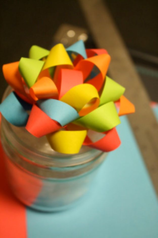 Creative Bows For Packages - Paper Bows - Make DIY Bows for Christmas Presents and Holiday Gifts - Cute and Easy Ideas for Making Your Own Bows and Ribbons - Step by Step Tutorials and Instructions for Tying A Bow - Cheap and Crafty Gift Wrapping Ideas on A Budget http://diyjoy.com/diy-bows-gifts-packages