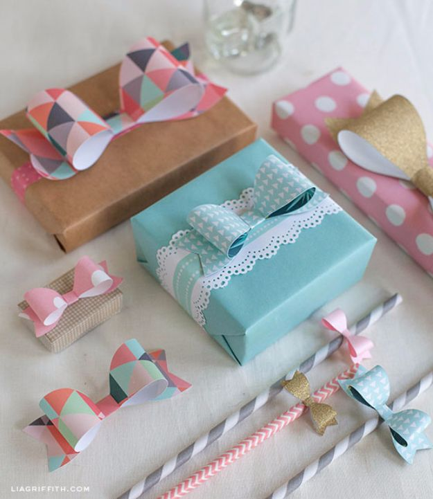 Creative Bows For Packages - Perfect Paper Bows - Make DIY Bows for Christmas Presents and Holiday Gifts - Cute and Easy Ideas for Making Your Own Bows and Ribbons - Step by Step Tutorials and Instructions for Tying A Bow - Cheap and Crafty Gift Wrapping Ideas on A Budget http://diyjoy.com/diy-bows-gifts-packages