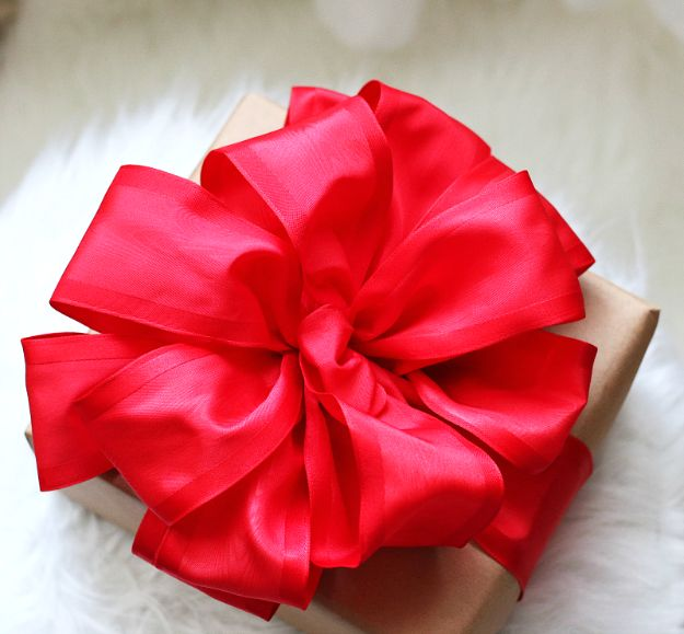 Creative Bows For Packages - Perfect Red Bow - Make DIY Bows for Christmas Presents and Holiday Gifts - Cute and Easy Ideas for Making Your Own Bows and Ribbons - Step by Step Tutorials and Instructions for Tying A Bow - Cheap and Crafty Gift Wrapping Ideas on A Budget http://diyjoy.com/diy-bows-gifts-packages