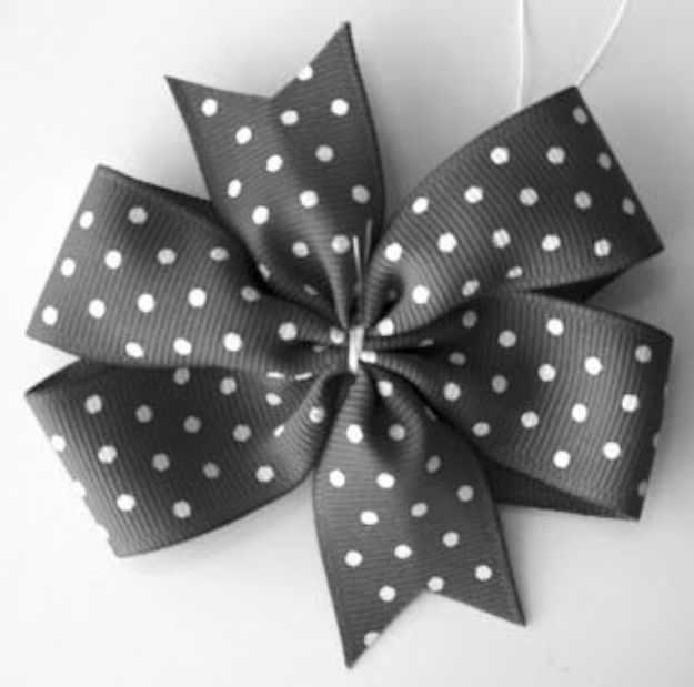 Creative Bows For Packages - Pinwheel Bow - Make DIY Bows for Christmas Presents and Holiday Gifts - Cute and Easy Ideas for Making Your Own Bows and Ribbons - Step by Step Tutorials and Instructions for Tying A Bow - Cheap and Crafty Gift Wrapping Ideas on A Budget http://diyjoy.com/diy-bows-gifts-packages