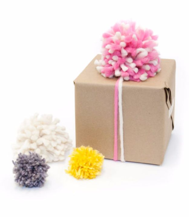 Creative Bows For Packages - Pom-Pom Gift Bows - Make DIY Bows for Christmas Presents and Holiday Gifts - Cute and Easy Ideas for Making Your Own Bows and Ribbons - Step by Step Tutorials and Instructions for Tying A Bow - Cheap and Crafty Gift Wrapping Ideas on A Budget http://diyjoy.com/diy-bows-gifts-packages