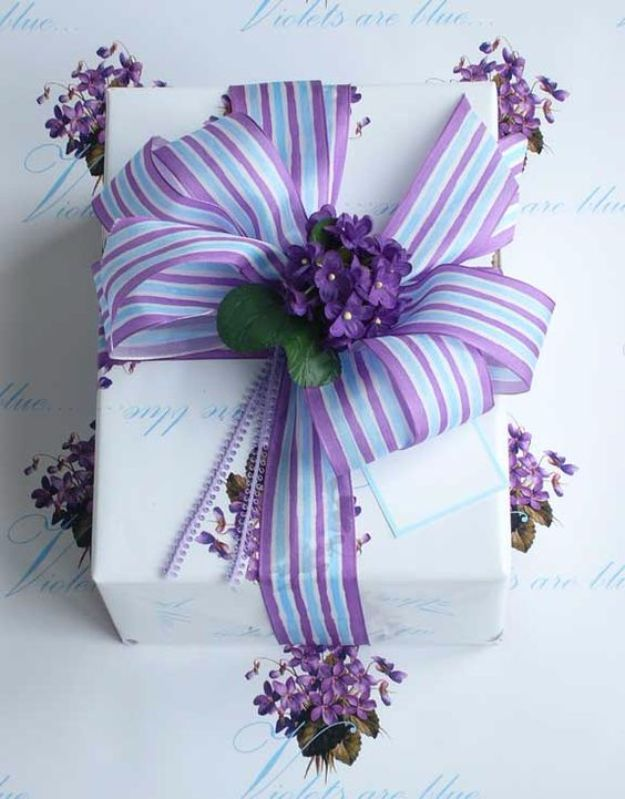Creative Bows For Packages - Purple Ribbon Bow - Make DIY Bows for Christmas Presents and Holiday Gifts - Cute and Easy Ideas for Making Your Own Bows and Ribbons - Step by Step Tutorials and Instructions for Tying A Bow - Cheap and Crafty Gift Wrapping Ideas on A Budget http://diyjoy.com/diy-bows-gifts-packages